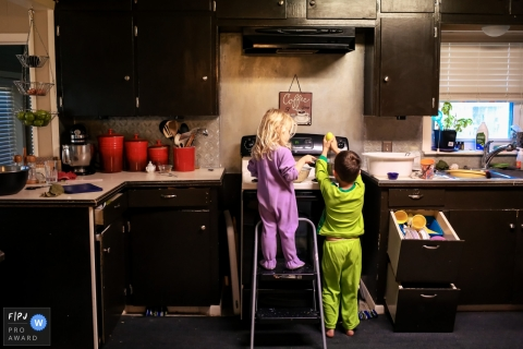 Day in the Life photography session at home in San Francisco showing the kids in PJs helping with breakfast