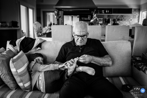Day in the Life Sao Paulo documentary family photography session with Grandpa checking on the childs feet