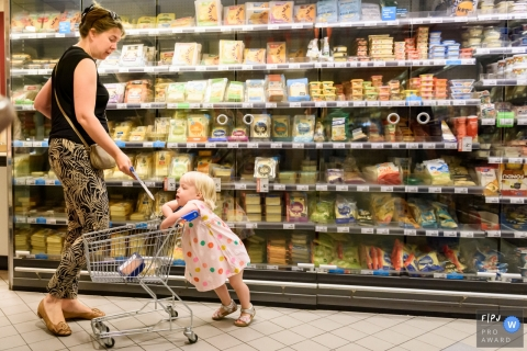 Netherlands Day in the Life Session of documentary family photography of a Girl in a Market shopping with mom