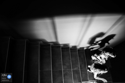PACA at home Day in the Life photography of kids in BW racing down the stairs