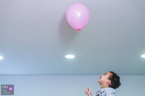 Campo Grande at home Day in the Life photography with a Boy with his balloon