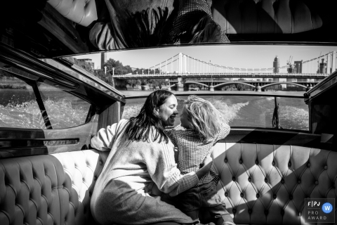 London Day in the Life Session of documentary family photography on a private boat to see London from the thames river