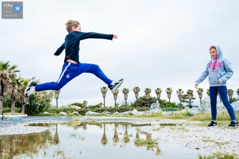 Day in the Life Perpignan documentary family photography session outdoors with some jumping Over the water