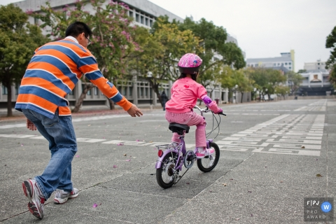 San Francisco at home Day in the Life photography capturing a girl riding a bike on two wheels for the first time