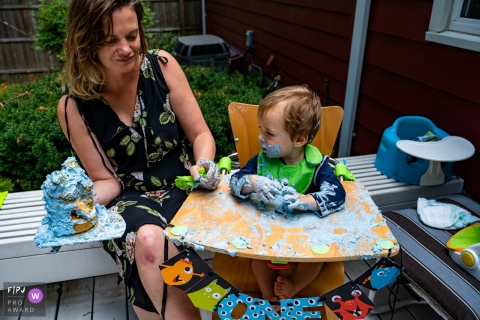 Connecticut at home Session of documentary family photography of a backyard birthday mess of a toddler with his cake