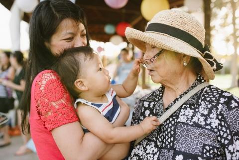 toddler grabs grandma's glasses off her face