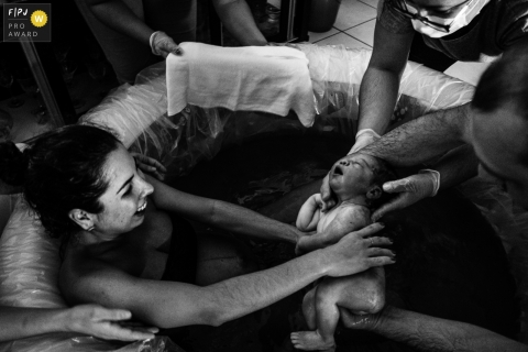Moment-driven Sao Paulo birth photography of a baby born into water at home