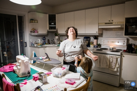 Montreal family photography. This image is a part of a series I did on single mother's homes during the Covid-19 Pandemic. It shows the reality of their everyday lives, routine and the relationship with their kids. Mom and daughter in one night's playdate