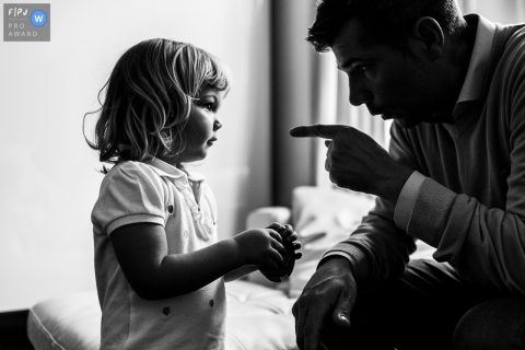 Moment-driven Belgium family photography capturing a father informing his daughter of someting important