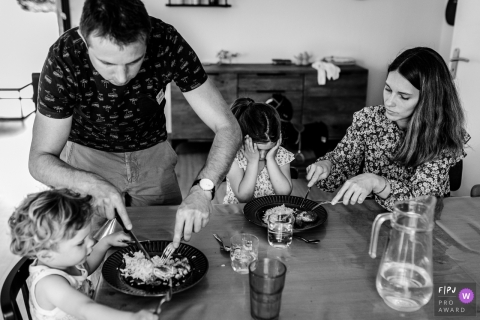 Moment driven Haute-Garonne family photojournalism image from a meal at table