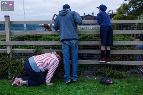 Moment-driven Bay Area, CA family photography of the ball over the fence