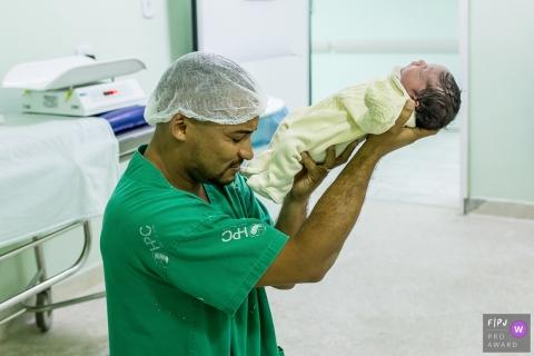 Hospital Plantadores de Cana birth photography showing the father consecrating the son