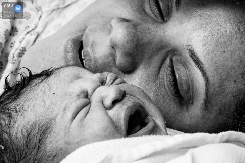 Hospital e Maternidade Santa Lúcia birth photo captured as a close up of the mother and baby