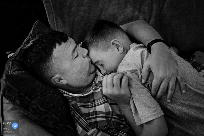 Key West family photojournalist captured this black and white photo of a father and son cuddling on the couch
