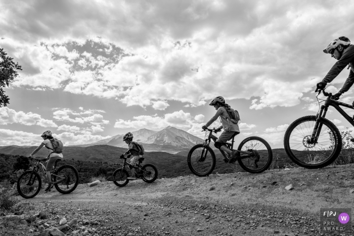 A family enjoys a bike ride through the mountains in this FPJA award-winning picture by a Boulder, CO family photographer.