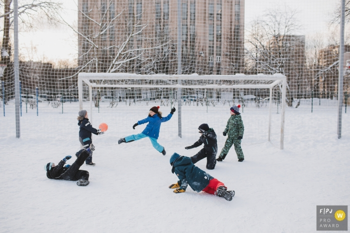 Saint-Petersburg family photojournalist captured this photo of kids playing soccer in a snow covered park
