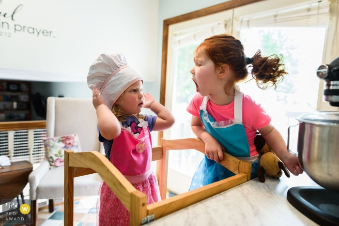 Boulder family photojournalist captured this image of siblings quarreling over who gets to lick the spoon
