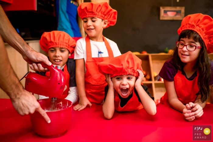 Brazil documentary family photographer captured this photo of a group of kids excitedly learning to cook together
