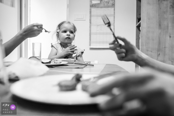 Slovenia Meal time with special diet for child. | Ljubljana family photography session in the home.
