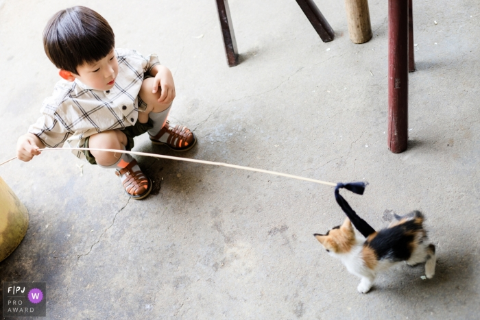 Mango Gu is a family photographer from