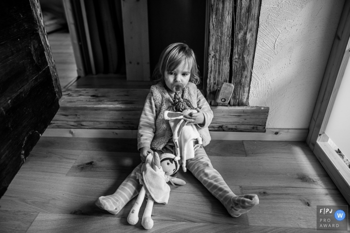 Savoie Family Photographer | Little girl sprawled on the floor with her pacifier and her blanket
