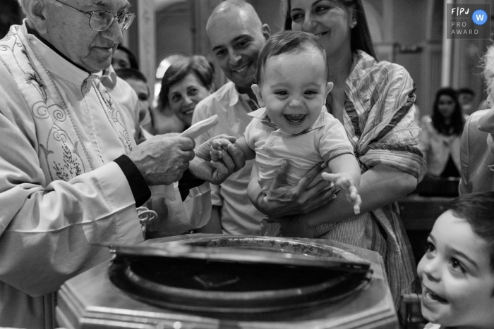 Modena and Emilia-Romagna family photography - A boy is getting baptized in church