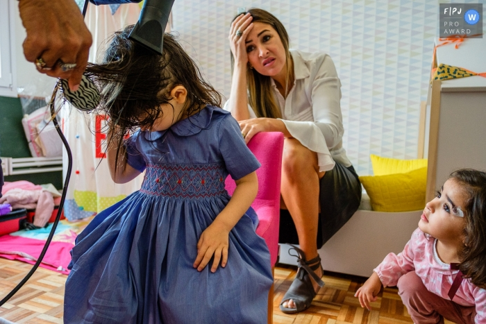 Sao Paulo Family Photography of young girl getting ready for her birthday party, we are late and her hair is NOT helping!