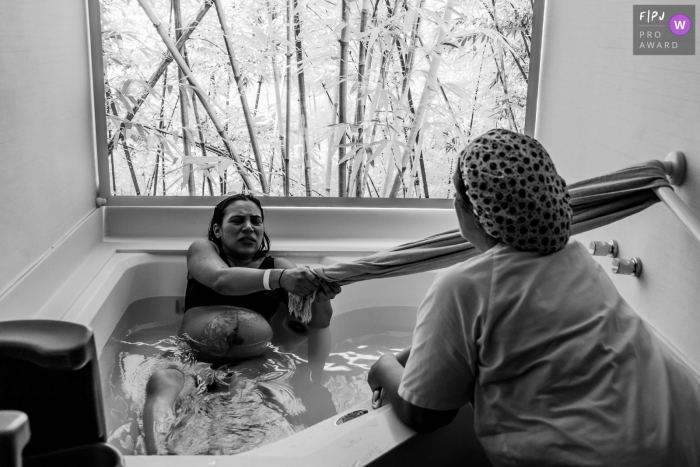 Rio de Janeiro, Brazil birthing photography of mom in a birth tub of water.
