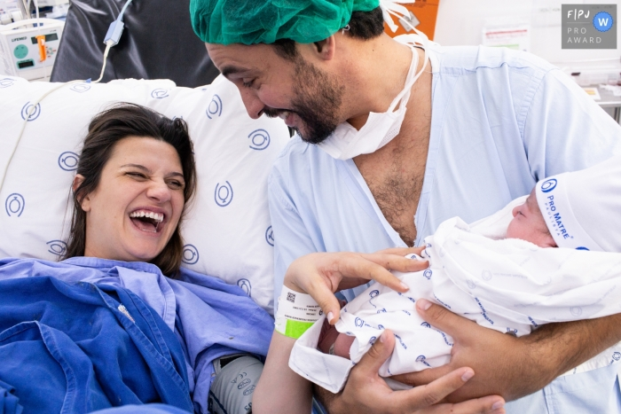 Sao Paulo, Brazil birthing photos of happy mom and dad holding baby in the hospital.