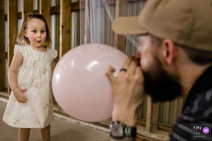 Canada family photographer - girl reacts in surprise at balloon in Ontario