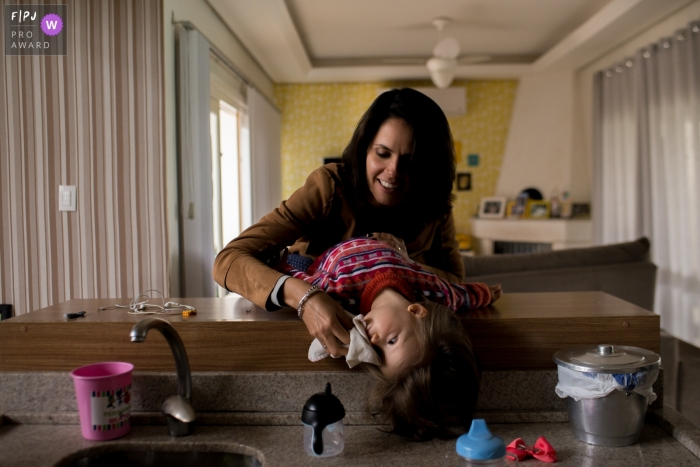 London documentary family photography - England mother and daughter at the kitchen sink.