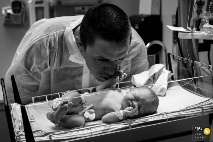 Ventura California birth photo session - Newborn Baby grabbing Dad's nose