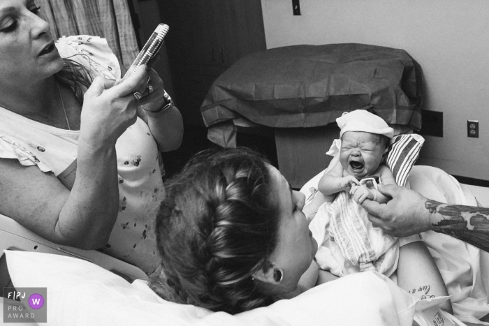 Washington Birthing Photography - Seattle family takes pictures of newborn baby with mom in the hospital