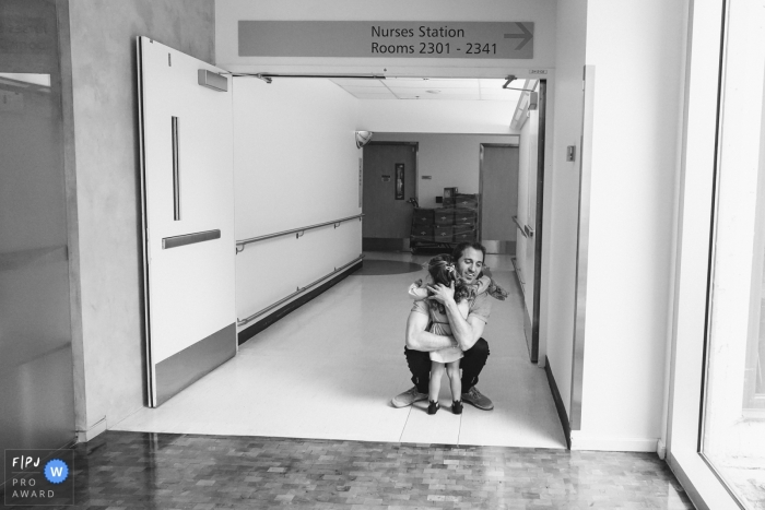 Seattle Washington family photos from birthing session | dad greeting daughter at hospital