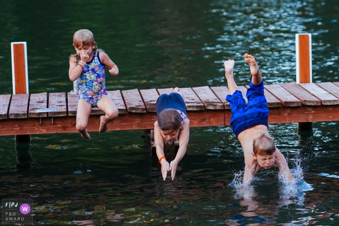 Seattle Washington documentary family photos of kids jumping into the water