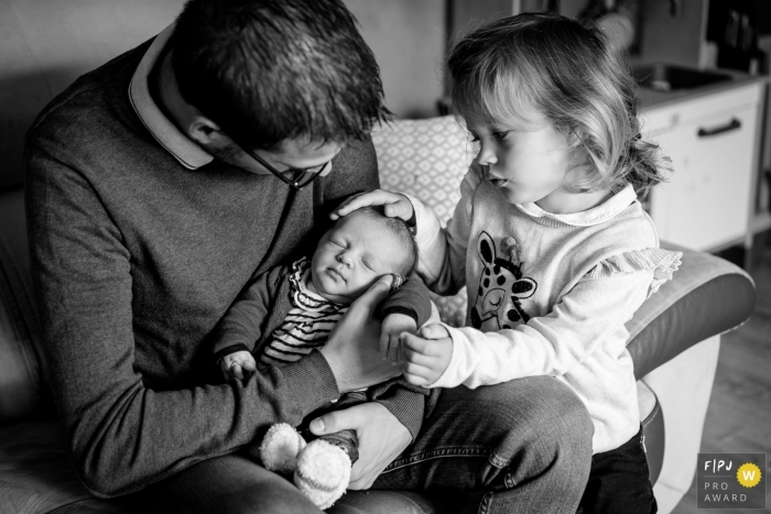 Nantes Family Photography   Sweet moment between a father and his daughters.