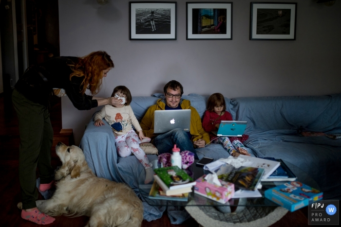Denmark family photography - At home on the couch with computers.
