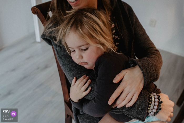 Girl is feel safe and comfortable being held by her mother | Netherlands Family Photography
