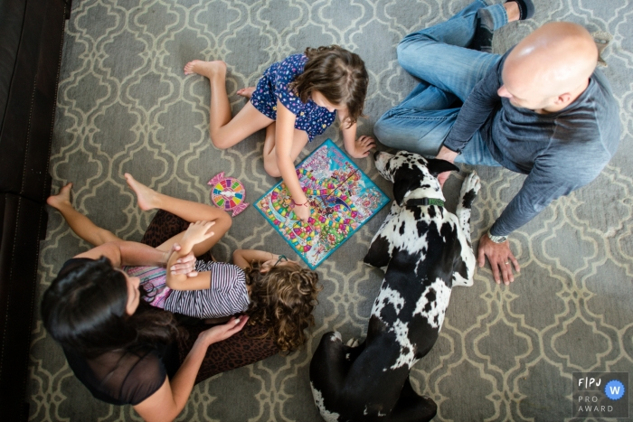 Sarasota Family board game night, of course the dog choses to join in the leisure time too. | Florida photography sessions in the home: DITL
