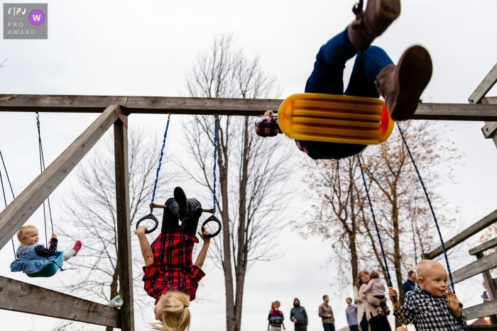 Ontario kids in varying stages of swinging - Family outing photography in Canada