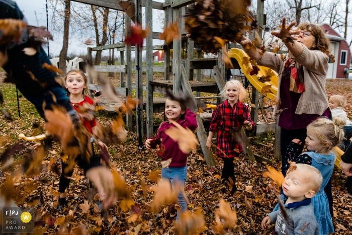 Fall time leaf fight with the family   Ontario Family Sessions