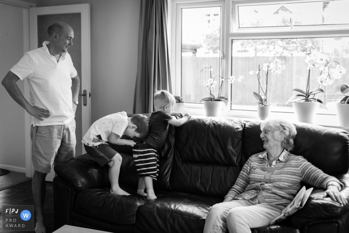 Family - big brother checking little brother's nappy | Cambridgeshire Family Photography