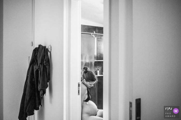 A quiet moment for a mom as she is in labor at the hospital | Campinas Birthing Photographer