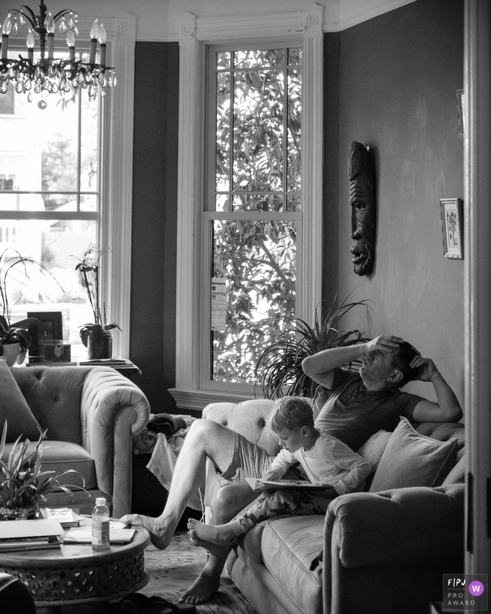 San FranciscoCalifornia family photography - A tired father helps his son learn to read.