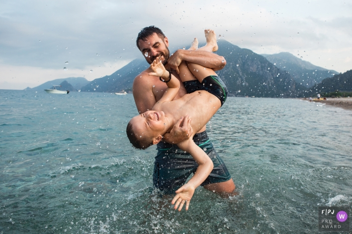 Father and son play in the water on their camping trip in Turkey | Family Photojournalism