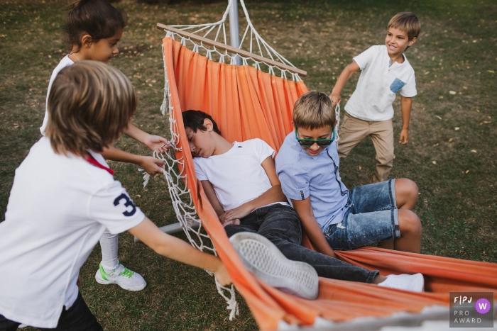 Shuvalovka Family Photography | Kids having fun on a hammock