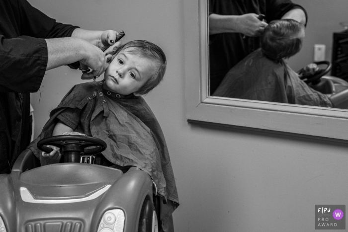 Connecticut family photography of a boy's First haircut... a little unsure of the whole situation.