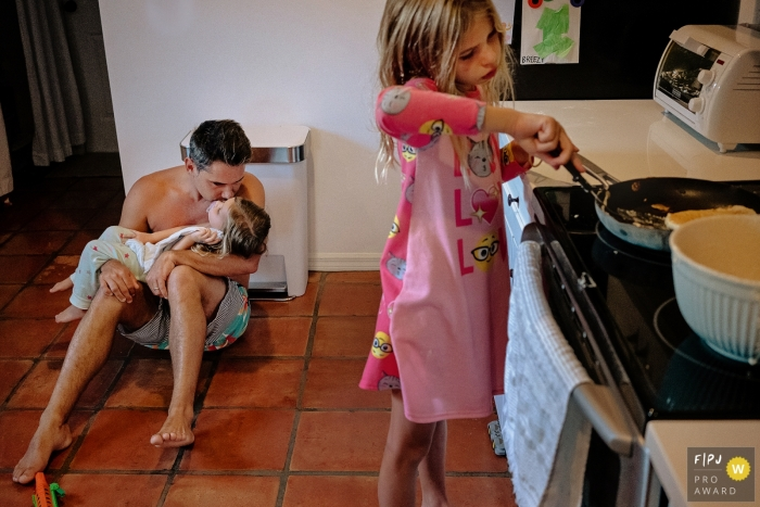 Daughter cooking for dad and sister - Florida family photography in-house
