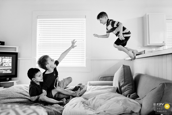 Kid jumping off the counter during their Florida in-home family photo session.