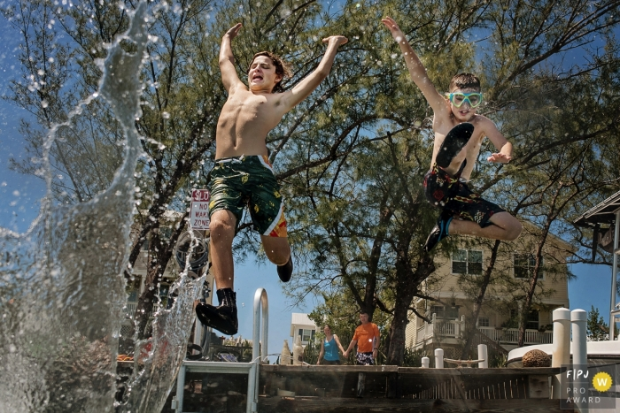 Key WestFlorida family summer photography session – two boys jumping in the ocean